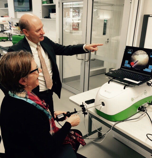 Dr Thomas Dean with a delegate on the green light simulator